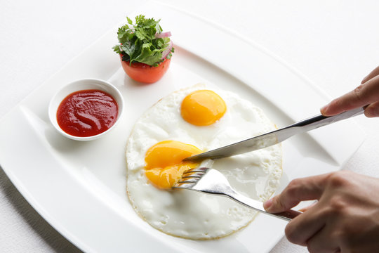 Sunny side up eggs served in the restoraunt for breakfast
