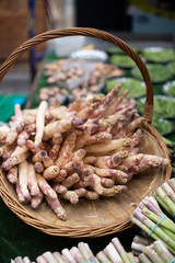 White asparagus in a market basket at the farmer's market in Paris