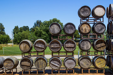 Vintage Wooden Wine Barrels On Display At Winery