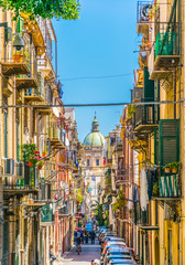 Photo on textile frame Palermo View of a narrow street leading to chiesa del carmine maggiore in Palermo, Sicily, Italy