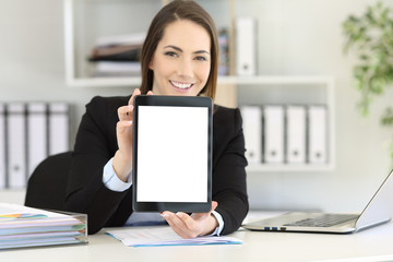Office worker showing a tablet screen mockup