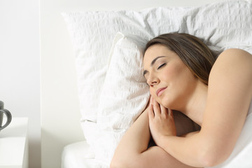 Portrait of a woman sleeping on a bed