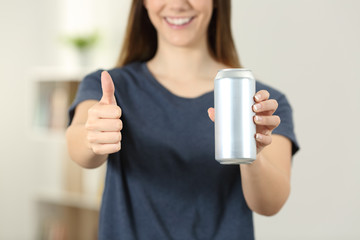Woman hands holding a soda drink can with thumbs up