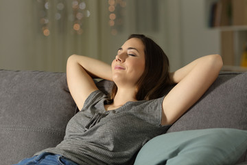 Woman relaxing at home in the night