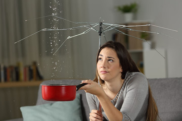 Woman suffering water leaks with a bad insurance concept