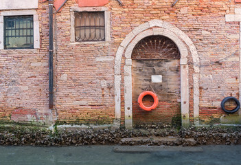 Life Preserver Hanging on a Door on a Canal in Venice, Italy