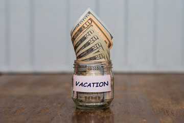 Vacation budget concept. Travel money savings in glass jar