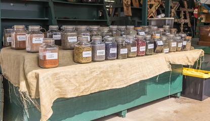 Assorted Herbal Tea and Spices:  An assortment of herbal tea on arranged on a graduated platform on a burlap sheet.