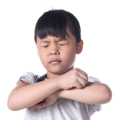 Portrait of a young asian girl scratching her arm.