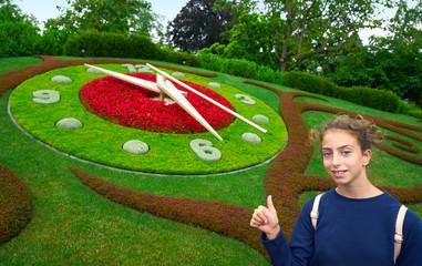 Flower clock garden in Geneve tourist girl Geneva