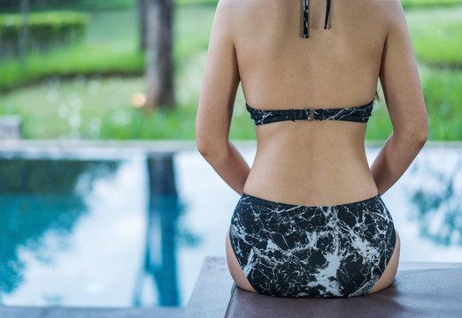 backside of a beautiful woman in pool