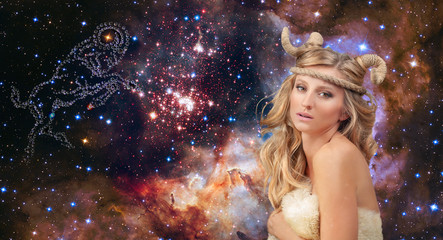 Astrology. Aries Zodiac Sign. Woman on night sky background