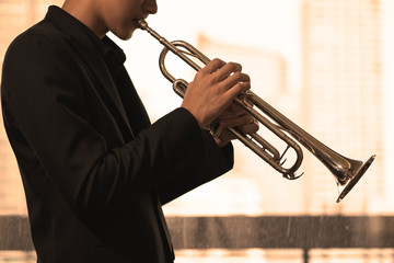close up trumpet player on warm tone