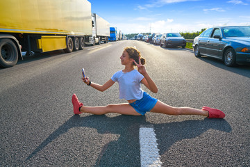 Split legs girl selfie photo in a traffic jam road