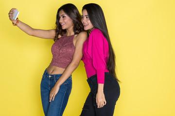 Two Hispanic Teen Sisters