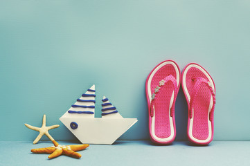 Summer background with a paper boat and sea star.