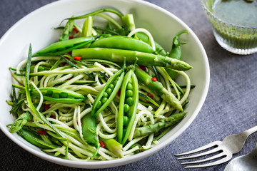 Zucchini Zoodles with Asparagus, Green Peas Salad with Basil dressing
