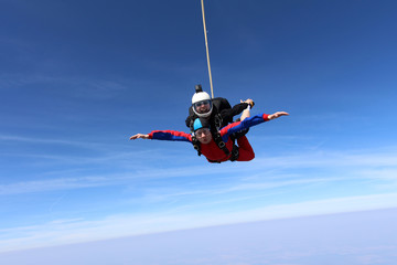 Tandem skydiving. Two men are in the sky.