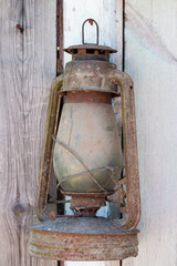 vintage kerosene Lamp on wooden wall