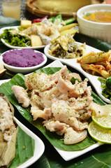 A set menu fried pork with salad, rice and soup .