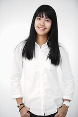 Portrait of asian teen cute girl looking at camera.