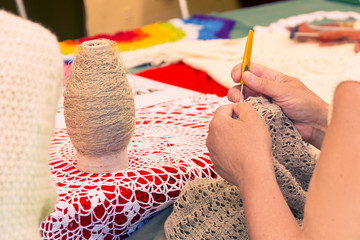Old woman crochet the tablecloth, senior lifestyle