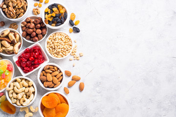 Nuts and dried fruits assortment on stone table top view. Fototapete