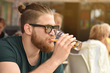 beard man drinking beer bear