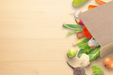 Fresh organic vegetables in paper bag on kitchen table. Free space fot text. Flat lay.