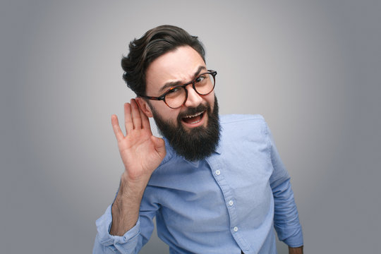Deaf man gesturing expressively