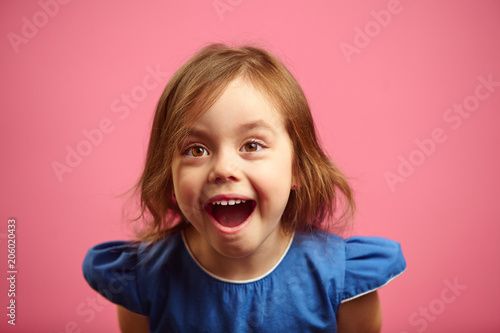 Surprised Little Girl With Eyes Wide Open And Mouth Stock Photo And