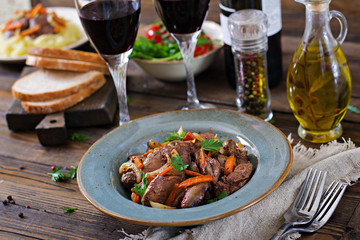 Fried chicken liver with vegetables. Healthy food.