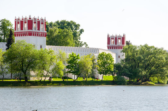 Panoramic view of the Novodevichy Convent, also Bogoroditse-Smolensky Monastery from the pond in Moscow city centre, Russia.