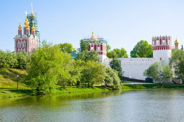 Novodevichy Convent, also Bogoroditse-Smolensky Monastery during the early summer seen from the pond in Moscow , Russia.
