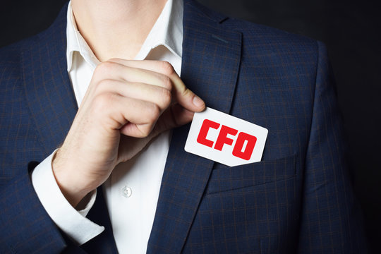 Businessman shows business card with the inscription:CFO