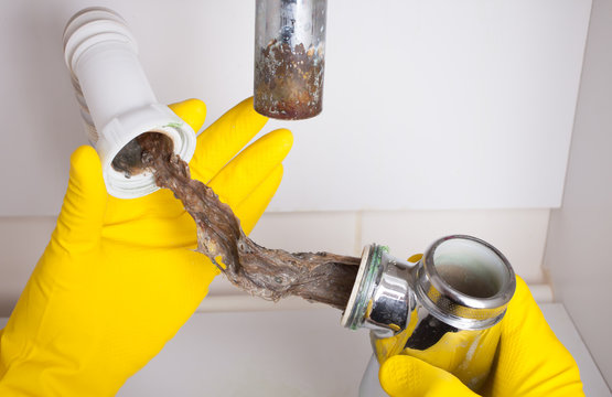 Washbasin's siphon cleaning in a bathroom