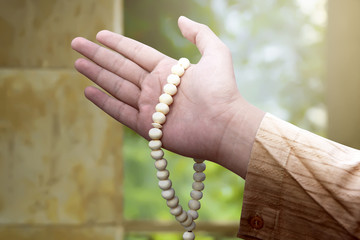 Muslim man holding prayer beads