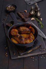 Flambe to pork with peach in pan