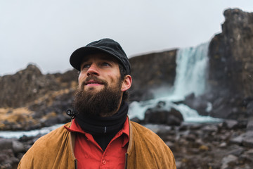 Bearded man near waterfall