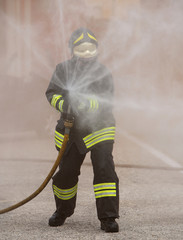 Firefighter uses a fire extinguisher to extinguish a fire