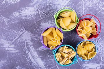 Pasta of different types in buckets
