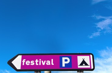 Sign post with festival location
