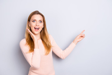 Just look over here! Good news innovation open mouth incredible people person emotion concept. Portrait of astonished pretty manager pointing on empty blank space isolated on gray background