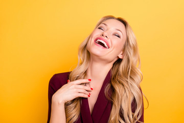 Portrait of positive cheerful sincerely woman laughing with close eyes wearing formalwear isolated on yellow background