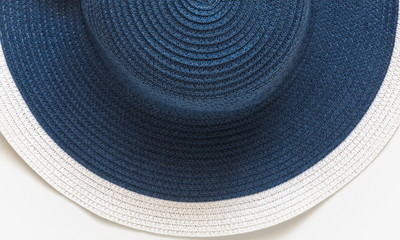 Beach hat as a background. Blue summer woman hat. Summer concept. Flat lay, top view, copy space