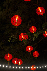 Red Chinese lanterns glowing at night