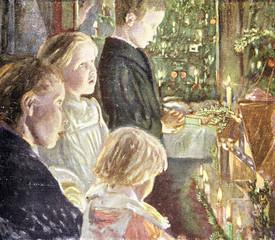 Kinder singen Weihnachtslieder am Weihnachtsbaum