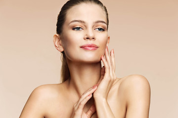 Young woman spa with beautiful make up. Photo of charming woman on beige background. Youth and skin care concept