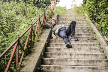 Man sleeping on the stairs