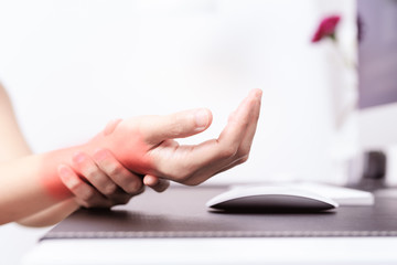 woman wrist arm pain long use mouse at office. office syndrome healthcare and medicine concept